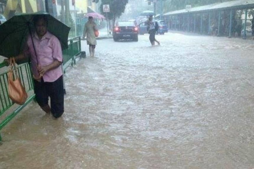 Photo taken near Commonwealth MRT Station at 9amon Thursday, Sept 5, 2013. Many parts of Singapore reported moderate to heavy thundery showers on Thursday morning, resulting in flash floods and traffic jams in some areas.-- FACEBOOK