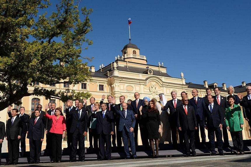 "Leaders of the Group of 20 (G-20) industrialised nations pose for a group photo outside the Konstantin Palace in St Petersburg, Sept. 6, 2013.  Recognising that global economic recovery is still too weak, the leaders backed a ""Saint Petersb"