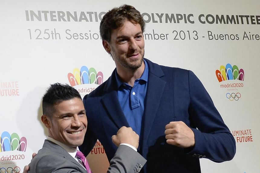 Spanish basketball player Pau Gasol (right) and World Boxing Council middleweight champion Sergio Martinez of Argentina in Buenos Aires on Sept 5, 2013. Gasol believes Madrid's unsuccessful attempts in the last two races to host the Olympics put