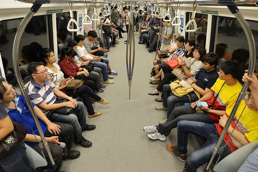 Commuters on board a train departing from Pasir Ris towards Joo Koon at about 6.40am on June 24, 2013. Customer satisfaction for the transport and logistics, public and private education sectors have risen, the Customer Satisfaction Index of Singapor
