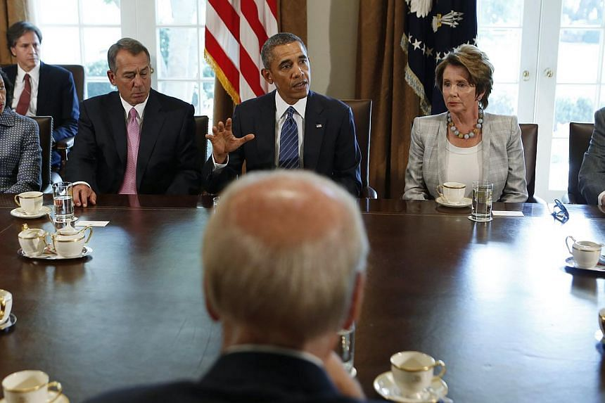 US President Obama (rear centre) meets with bipartisan Congressional leaders in the Cabinet Room at the White House in Washington to discuss a military response to Syria, on Sept 3, 2013. Obama administration officials making the case for a US milita
