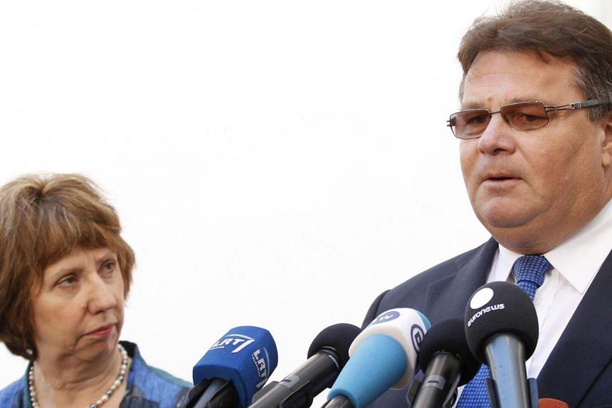 Lithuanian minister Linas Linkevicius (right) arrives for a meeting of European Union foreign ministers with European foreign policy chief Catherine Ashton in Vilnius, Lithuania, Friday, Sept 6, 2013. European Union foreign ministers g