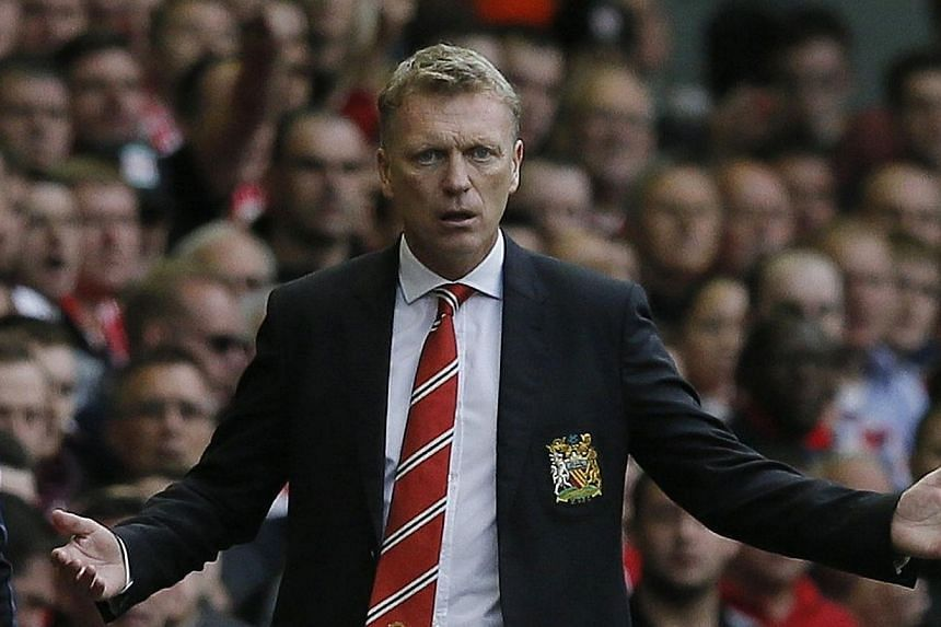 Manchester United's manager David Moyes during a match against Liverpool at Anfield on Sept 1, 2013. United's assistant coach Steve Round has defended Moyes by insisting that the club's new manager is ready for the challenge of life at Old Trafford.&