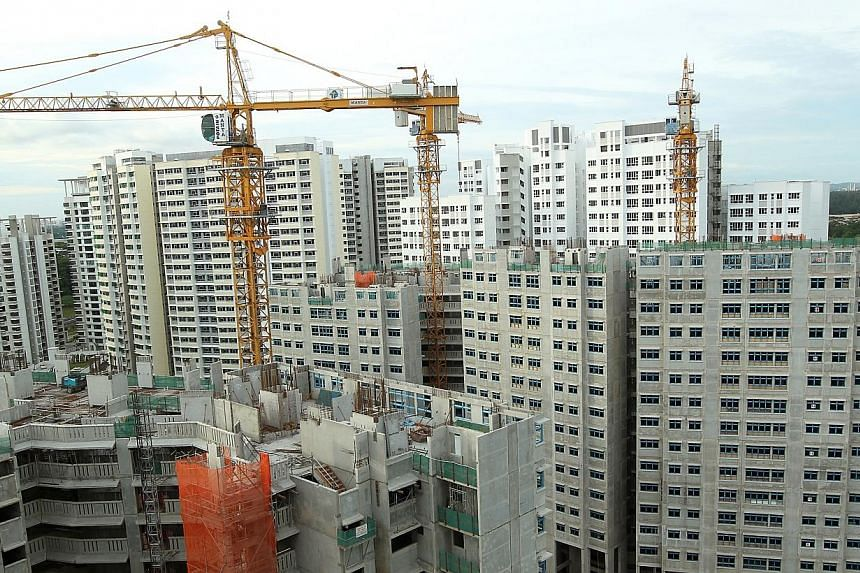 Build-To-Order flats under construction at Fernvale Link. The Housing Board has completed 9,000 flats this year, and is on track to deliver its promised 13,600 flats by the end of the year. -- ST FILE PHOTO: SEAH KWANG PENG