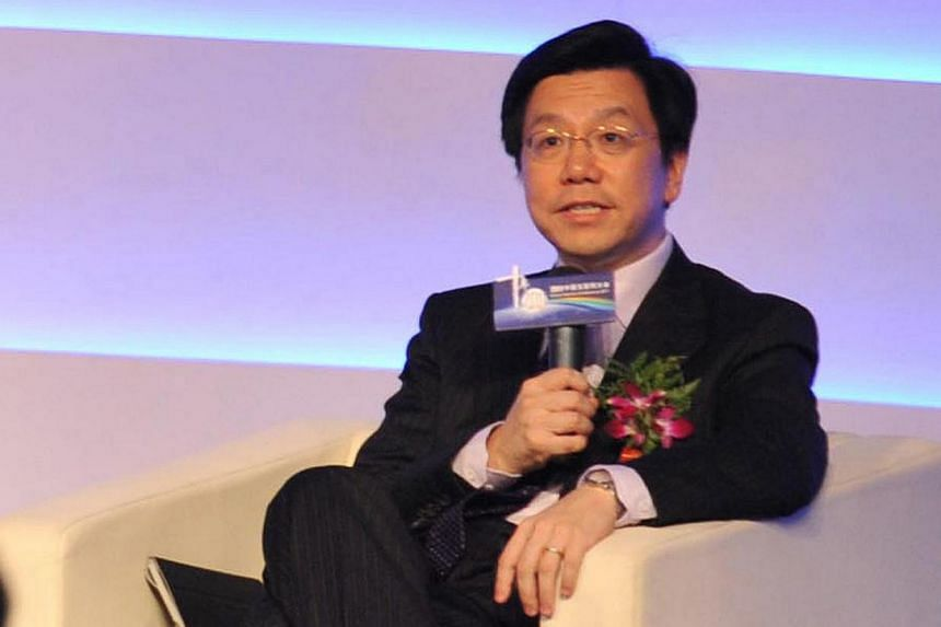 This picture taken on August 23, 2011 shows Mr Lee Kaifu, a former head of Google China and One of China's most popular microbloggers, delivering a speech on 2011 China Internet Conference in Beijing. Mr Lee received a huge outpouring of sympathy on