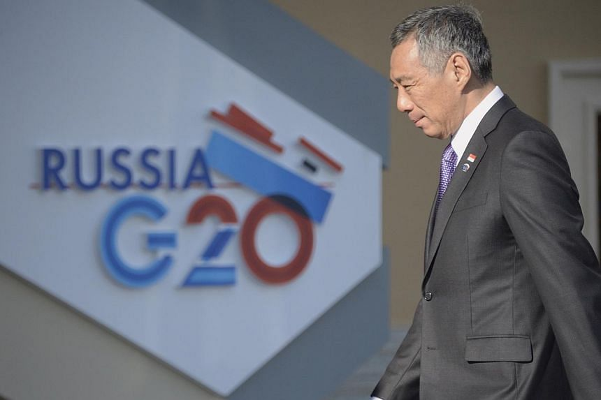 Prime Minister Lee Hsien Loong arrives for the start of the G-20 summit on Sept 5, 2013, in St Petersburg. MrLee has laid out Singapore's position on the use of chemical weapons in Syria, saying that the perpetrators must be punished.-- P