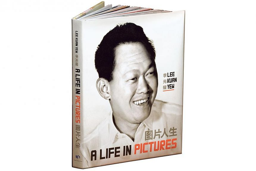 Lee Kuan Yew: A Life In Pictures is a bilingual pictorial book published by Straits Times Press to commemorate Mr Lee's 90th birthday on Sept 16. -- ST PHOTO: MUGILAN RAJASEGERAN