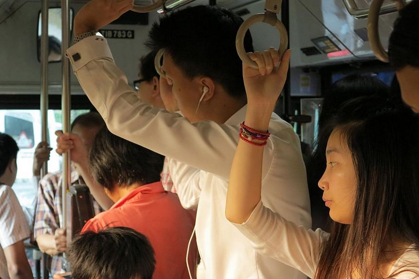 BUT STILL PACKED: The service 106 bus by the time it reached Bukit Batok East Avenue 3 at around 8.30am. Commuters feel some services are still too crowded. SHORTER WAITING TIMES...: Commuters boarding service 106 at Bukit Batok bus interchange. Peak