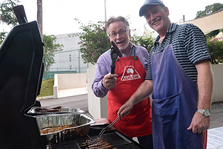 Australian High Commissioner to Singapore Philip Green (left) at the sausage sizzle at the Australian High Commissionon Napier Road on Saturday, September 7, 2013. As Australiansstart digesting the results of the election, their expatriat
