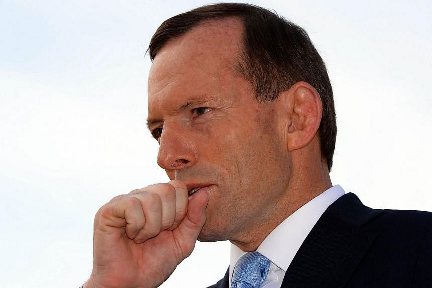 Australian opposition leader Tony Abbott waits for his live interview outside a polling station in Sydney on Saturday, Sept 7, 2013.The Australian Broadcasting Corporation on Saturday called a clear win for the Tony Abbott-led conservative oppo