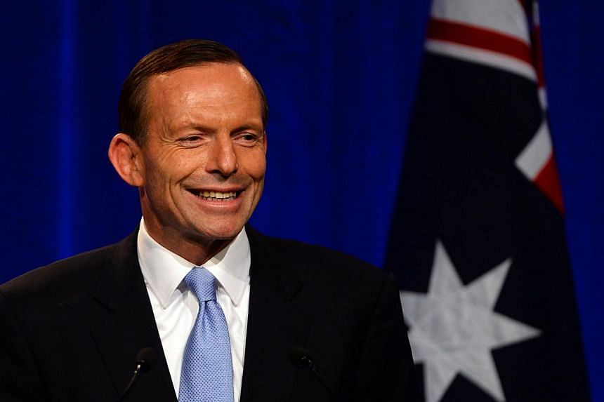 Conservative challenger Tony Abbott delivers his speech in Sydney on Saturday, Sept 7, 2013. Mr Abbott on Saturday promised to provide a trustworthy, competent government after winning a resounding victory in national polls, which ended six years of