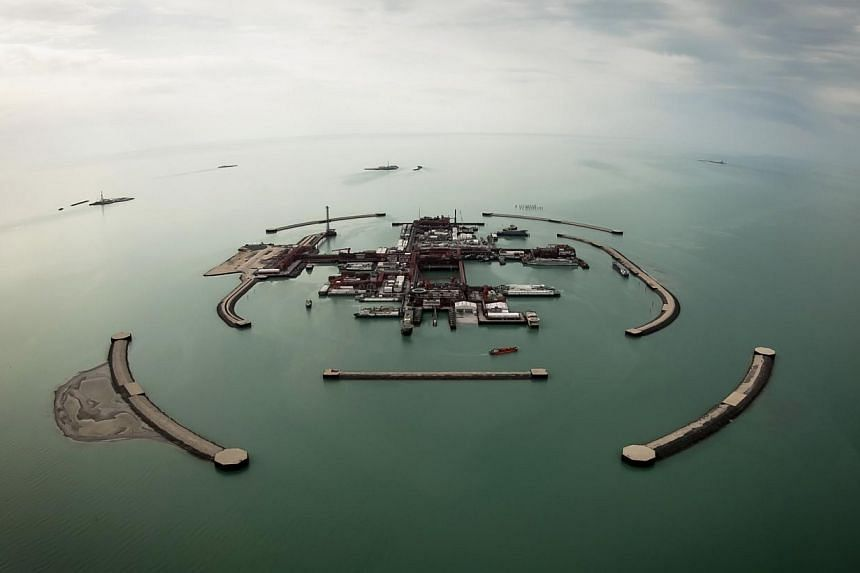 An aerial view shows artificial islands on Kashagan offshore oil field in the Caspian sea, western Kazakhstan on April 7, 2013.  Chinese President Xi Jinping on Saturday will oversee China's entry into Kashagan as he tours post-Soviet Centr