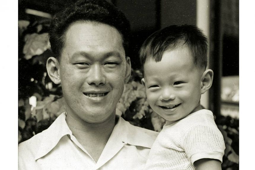 Mr Lee holding Hsien Loong at home in the 1950s. -- PHOTO: LEE KUAN YEW COLLECTION