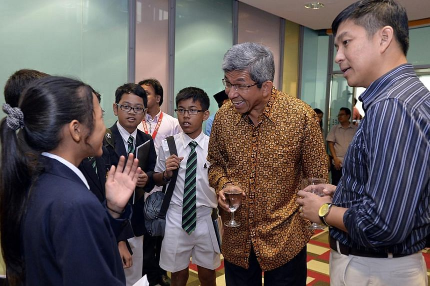 (From right) Acting Minister for Manpower Tan Chuan-Jin and Minister for Communications and Information, and Minister-In-Charge of Muslim Affairs Yaacob Ibrahim with students at the annual Anugerah Mendaki award ceremony. A record