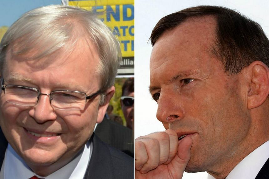 Australia's Labor Prime Minister Kevin Rudd (left) on Saturday, Sept 7, 2013, conceded election defeat to conservative challenger Tony Abbott (right), and wished his rival well. -- PHOTOS: AFP
