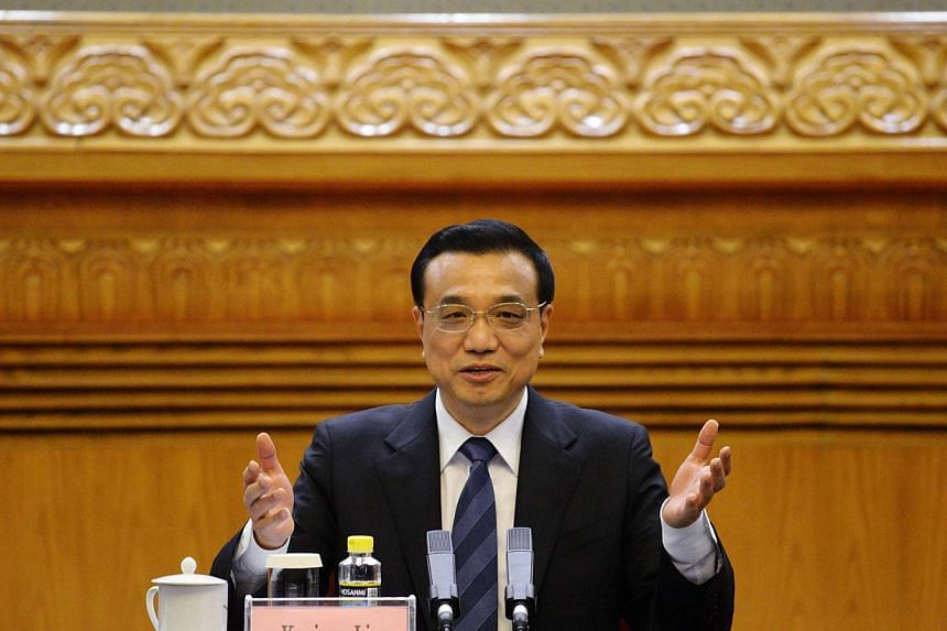 Chinese Premier Li Keqiang speaks during a meeting with business leaders who will be attending the upcoming Fortune Global Forum, at the Great Hall of the People in Beijing in this June 5, 2013 file photo. China's premier, Li Keqiang, wants his plan