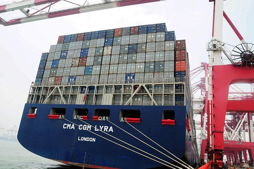 A container ship berths in Qingdao port, east China's Shandong province on July 10, 2013. China's trade performance was better than expected in August, as stronger exports to recovering overseas economies caused the trade surplus to widen to US$28.6