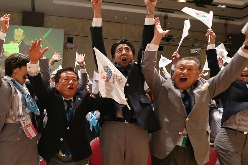 Japanese Prime Minister Shinzo Abe (centre) celebrates alongside Tokyo 2020 delegation members after IOC president Jacques Rogge announced the Japanese capital to be the winner of the bid to host the 2020 Summer Olympic Games, during the 125th sessio