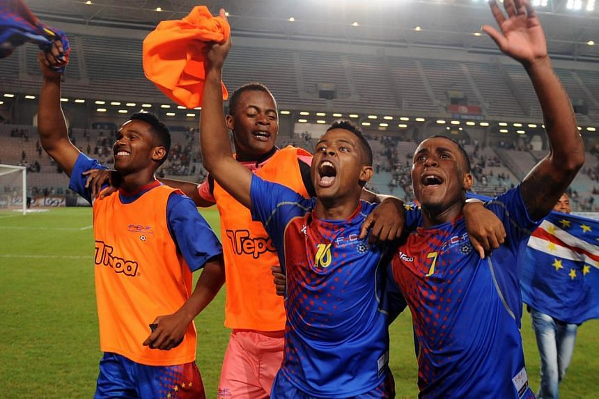 Cape Verde's players celebrate after their qualification against Tunisia during a Fifa World Cup qualification match between Tunisia and Cape Verde on Sept 7, 2013 in Rades Olympic Stadium in Tunis. Cape Verde won 2-0. Cape Verde Islands shocked&nbsp