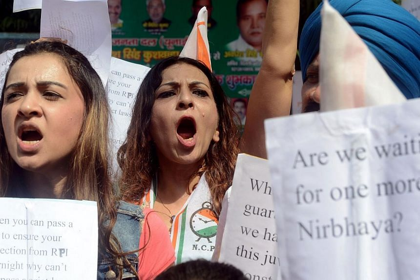 Indian activists shout slogans demanding an amendment of juvenile justice laws during a protest against the sentence of a juvenile convicted in the December 2012 gang-rape of a student, in New Delhi on Friday, Sept 6, 2013.The family of a stude