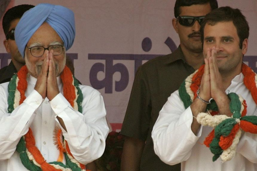 """Indian Prime Minister Manmohan Singh (left) has endorsed Rahul Gandhi to lead the ruling Congress party, saying he would be """"happy"""" to work under the scion of the Nehru-Gandhi dynasty, reports said on Sunday. -- PHOTO: AFP"""