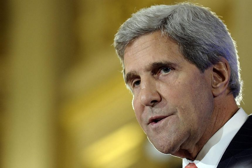 US Secretary of State John Kerry (above) speaks during a news conference with French Foreign Affairs Minister Laurent Fabius at the Ministry of Foreign Affairs in Paris on Saturday, Sept 7, 2013. Mr Kerry continues a diplomatic offensive in Europe on