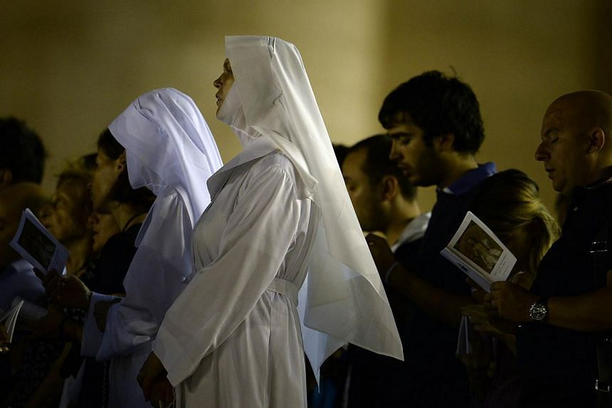 Nuns pray in St Peter's squareat the Vatican on Saturday, Sept 7, 2013. -- PHOTO: AFP