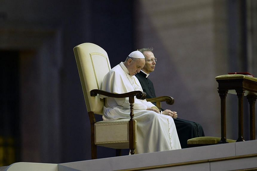 Pope Francis prays in St Peter's squareat the Vatican on Saturday, Sept 7, 2013. - PHOTO: AFP