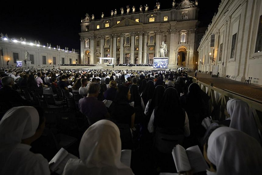 Nuns pray in St Peter's squareduring a mass at the Vatican on Saturday, Sept 7, 2013. -- PHOTO: AFP