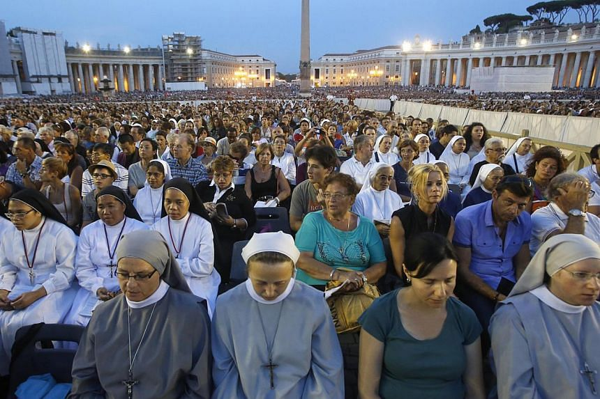 Faithful pray during a vigil for peace attended by Pope Francis in St. Peter's Square at the Vatican on Saturday, Sept 7, 2013. -- PHOTO: AP