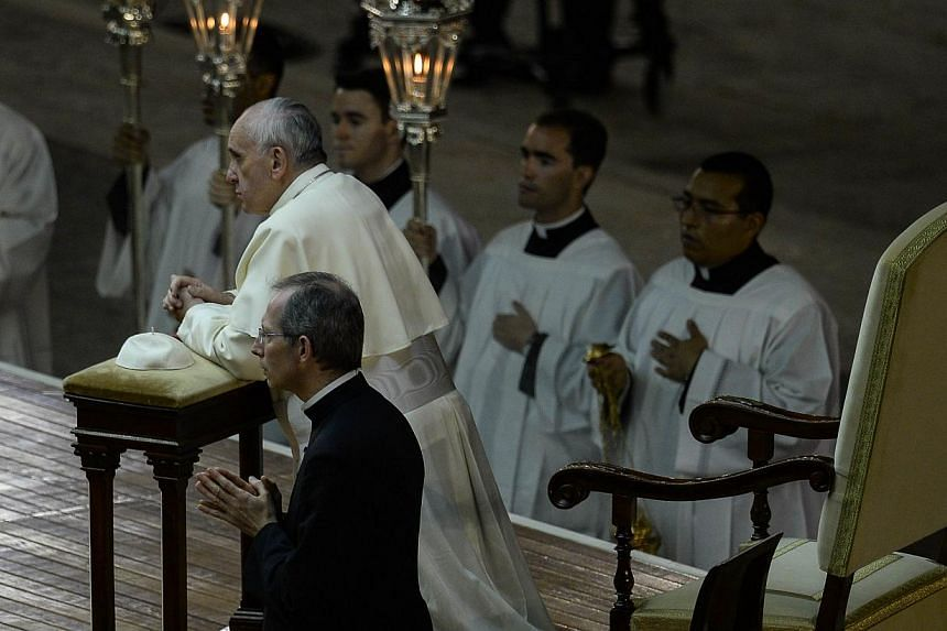Pope Francis leads a mass in St Peter's square at the Vatican on Saturday, Sept 7, 2013. -- PHOTO: AFP