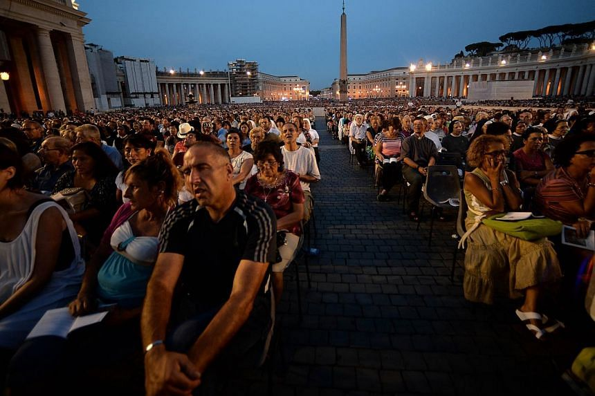 People pray in St Peter's square at the Vatican on Saturday, Sept 7, 2013. -- PHOTO: AFP