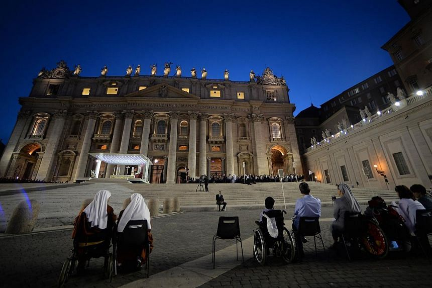 People pray in St Peter's squareat the Vatican on Saturday, Sept 7, 2013. -- PHOTO: AFP
