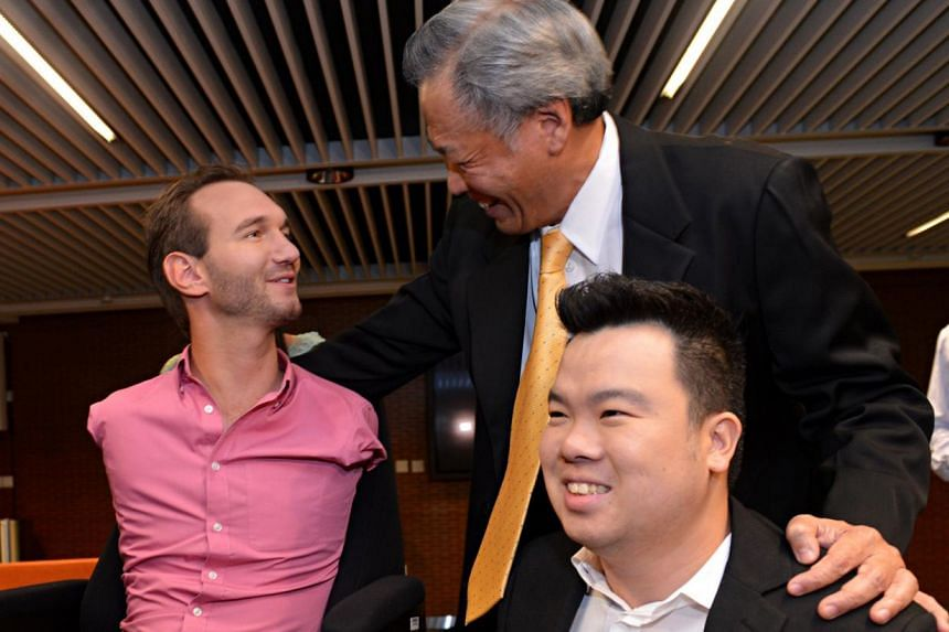 Dr Ng Eng Hen with motivational speaker Nick Vujicic and navy serviceman Jason Chee yesterday. ME 2 Chee says his strong willpower has kept him going and he draws inspiration from several disabled people, including Mr Vujicic.