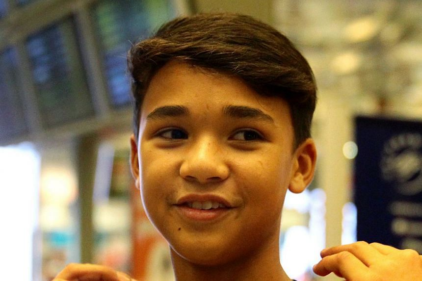 Irfan, 16, and Ikhsan Fandi (above), 14, will fly to Santiago to conclude the deal while Fandi's lawyers will vet the fine print to avoid any complication. -- ST FILE PHOTO