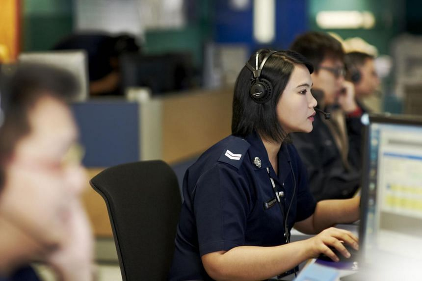 A police officer manning the 999 emergency hotline. More than 50 per cent of all calls received on the hotline yearly over the past three years were nuisance calls. -- PHOTO: SINGAPORE POLICE FORCE