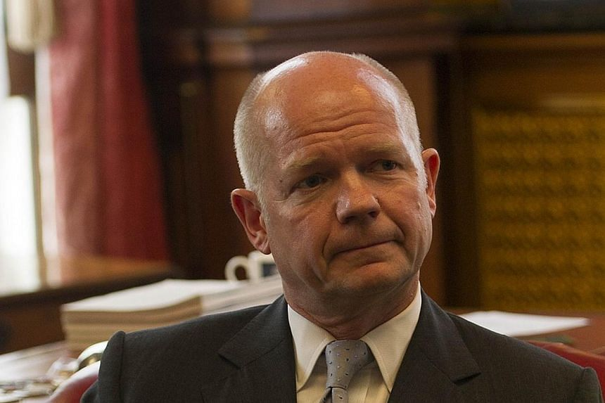 British Foreign Secretary William Hague (above) meets with the president of the Syrian National Coalition Ahmad al-Assi al-Jarba in central London on Thursday, Sept 5, 2013. Mr Hague called on Sunday for a strong response to the use of chemical weapo