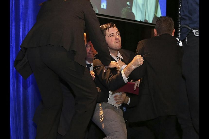 An intruder who climbed on stage with Australia's next prime minister Tony Abbott and his family on victory night is an anti-coal activist who calls himself Twiggy Palmcock, reports said on Sunday. -- PHOTO: AFP