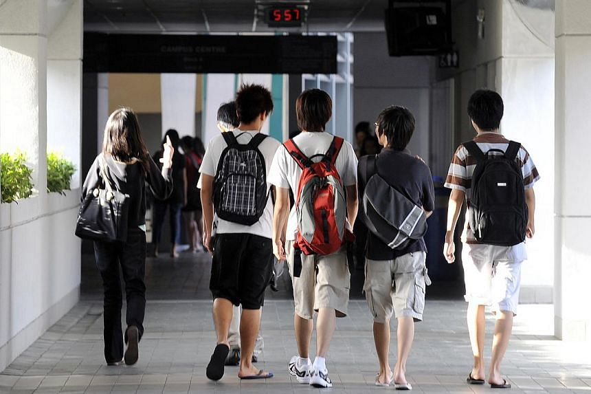 Nanyang Polytechnic students at their campus in Yio Chu Kang. About $1 billion will be spent on extra classrooms, laboratories and other facilities at Singapore's five polytechnics, to cope with the rising number of students going the polytechnic rou