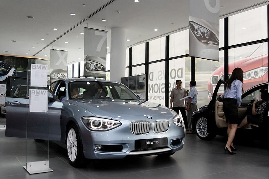 Customers at the Performance Motors (BMW) showroom. From February next year, the Government will include a vehicle's engine power as a new criterion to the way Certificate of Entitlements (COE) are classified. Pictured is a 1.6 litre BMW 116i. A