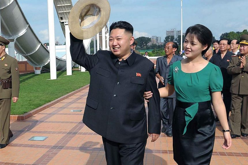 North Korean leader Kim Jong Un and his wife Ri Sol Ju attend the opening ceremony of the Rungna People's Pleasure Ground on Rungna Islet along the Taedong River in Pyongyang in this July 25, 2012 file photograph. Kim Jong Un has a baby daughter, acc