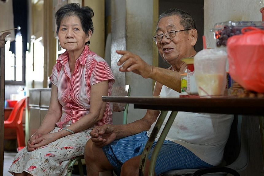 Mr Tan Ah Seng, 83, and his wife who has dementia, Mrs Ng Soon Ai, 78, seen here in their home in Circuit Road.Patients who require interim care while waiting for long-term funding will receive help for an extra six months under the HomeCare As
