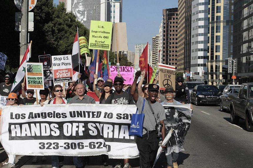 Protesters march on Wilshire Boulevard during an anti-war rally in Los Angeles, California on Saturday, Sept 7, 2013.The American public strongly opposes a US military intervention in Syria, despite a majority believing that President Bashar al