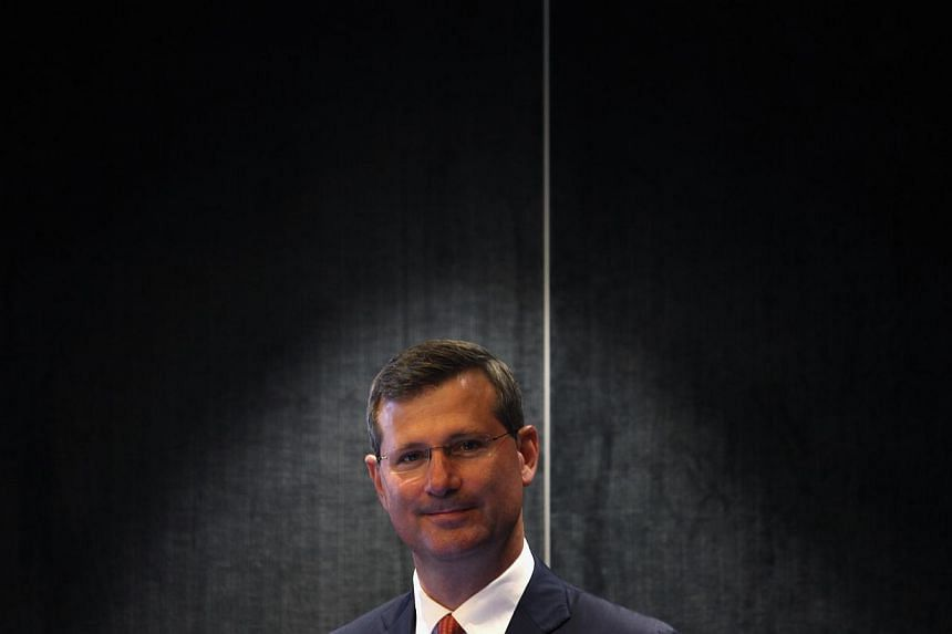 Alan Davies, chief executive of Rio Tinto's diamonds and minerals division, attends a news conference in Hong Kong Sept 6, 2013. The Argyle Pink Diamond Tender, showcasing the finest coloured diamonds from Rio Tinto Ltd's mine in north-west Australia