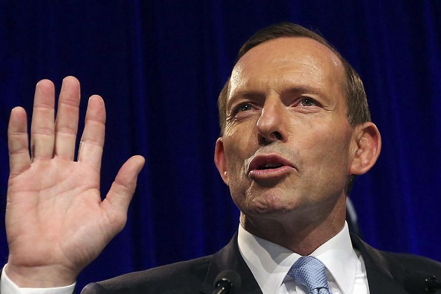 Tony Abbott speaks to supporters in Sydney, Saturday, Sept 7, 2013, following his win in Australia's national election. Australian Prime Minister-elect Tony Abbott on Monday began the transition to government as he faced potential hurdles in the uppe