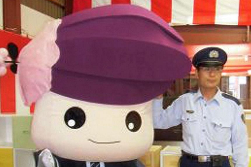 This handout photo taken on Sept 3, 2013, shows a version of Katakkuri-chan, the mascot of Asahikawa Prison, in Asahikawa, some 900km north of Tokyo. The Japanese prison housing a range of convicted criminals has unveiled the cuddly life-size mascot