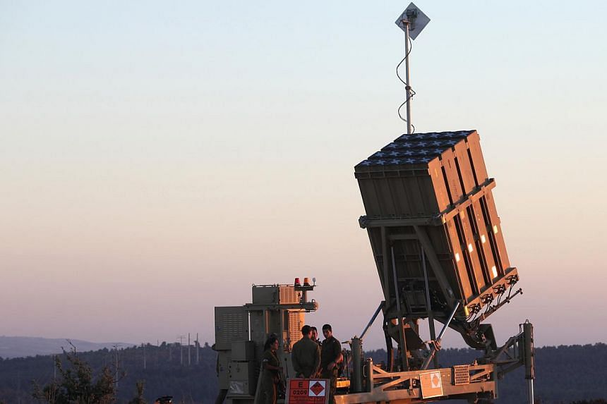 Israeli soldiers are seen near an Iron Dome battery near Jerusalem, Sunday, Sept 8, 2013. Israel deployed its Iron Dome missile defence system near Jerusalem Sunday, an AFP correspondent said, as the United States lobbied for domestic and internation