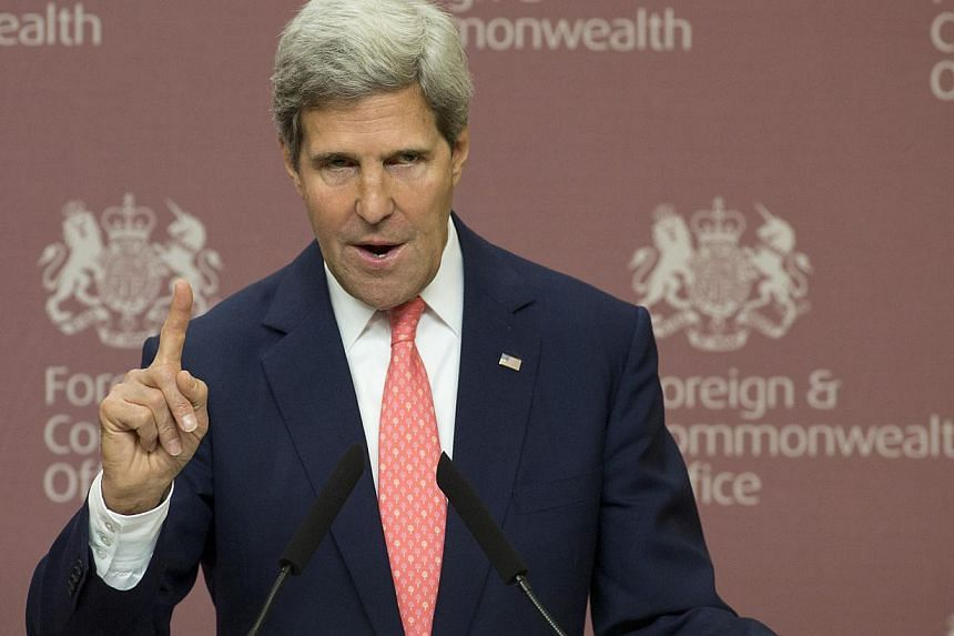 In this Sept. 9, 2013, photo, Secretary of State John Kerry gestures during a press conference with Britain Foreign Secretary William Hague at Foreign Office in London. At first it seemed like just another of John Kerry's musings - Syria could stop t
