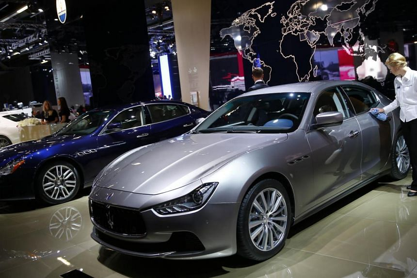 A Maserati Ghibli car is polished by a worker during a media preview day at the Frankfurt Motor Show (IAA) Tuesday, Sept 10, 2013. Italian luxury carmaker Maserati expects its sales to jump to about 16,000 cars this year from 6,300 last year, its chi