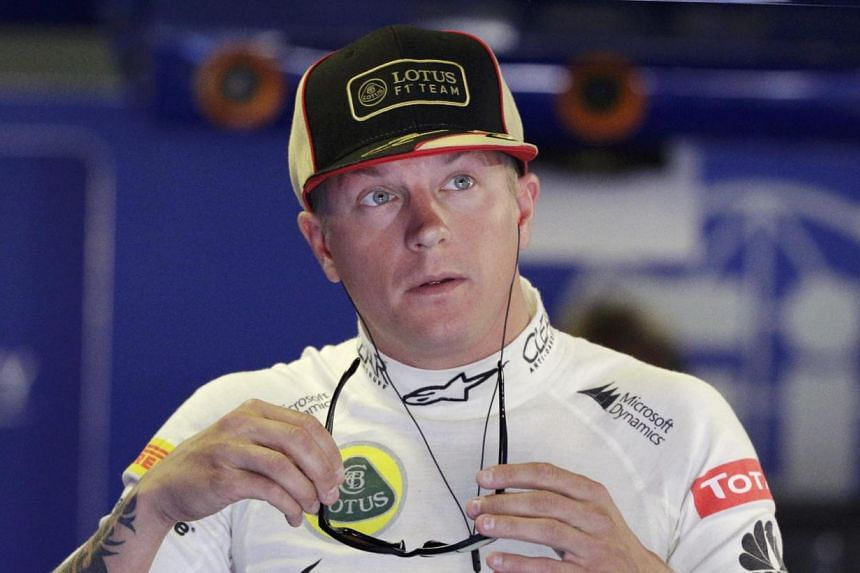 Kimi Raikkonen (above) is poised to make a decision on his future in Formula One this week, amid growing speculation that he will leave Lotus and rejoin Ferrari for 2014. -- FILE PHOTO: REUTERS